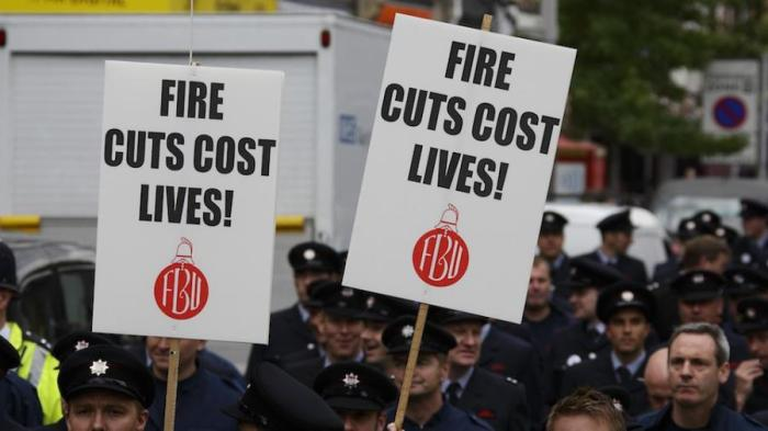 firefighters-holding-cuts-placards